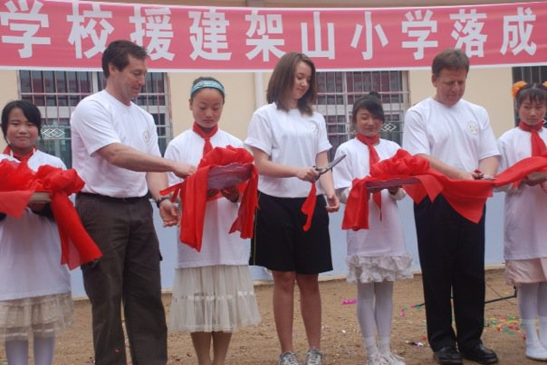 Opening a new school rebuilt after a 2008 earthquake in China.